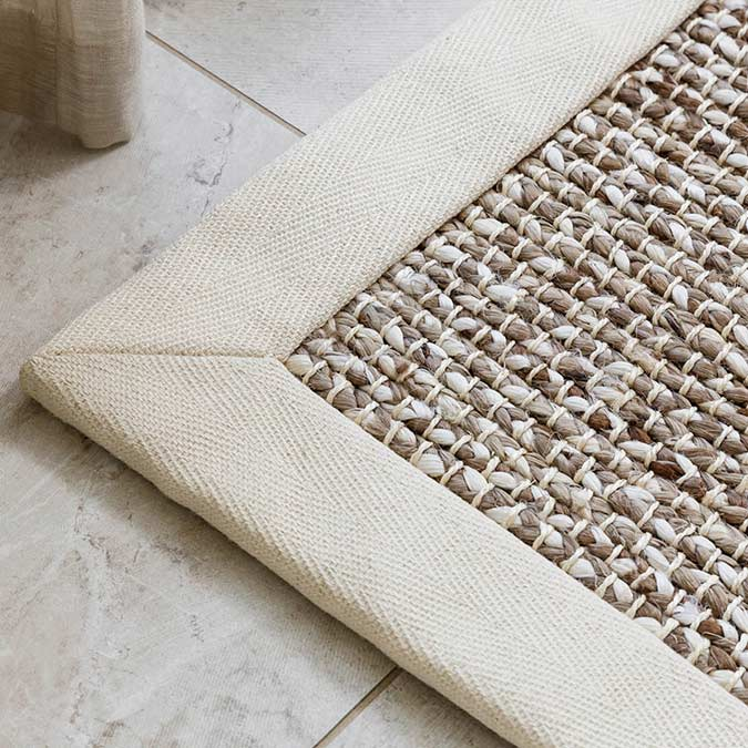 tortington area rug in color pearl with mitered corner