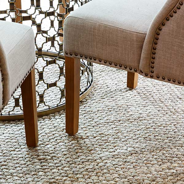 ground your space with a natural jute rug or carpet