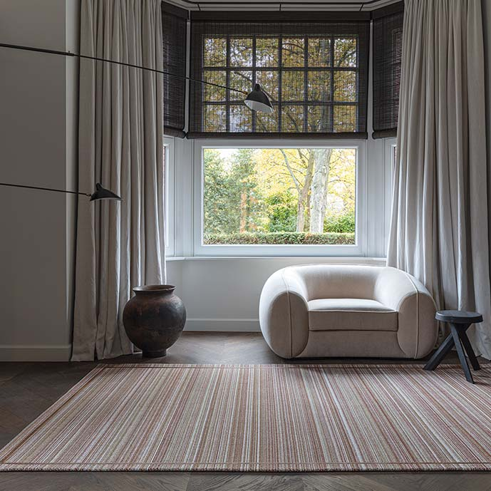 ambiance: earthy hues of color auburn as an area rug warm up a space