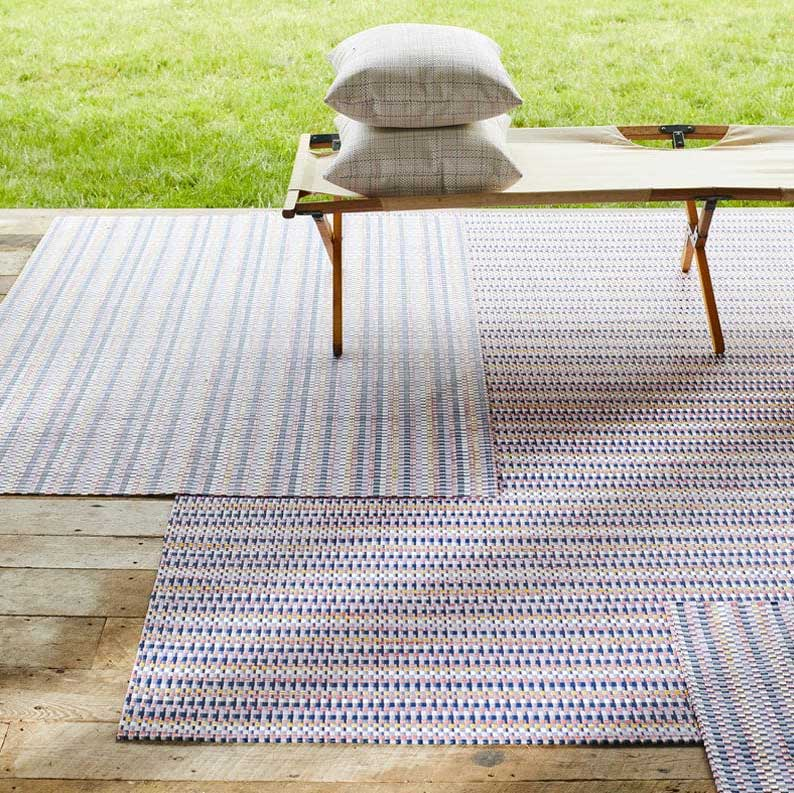 heddle rugs layered, highlighting the mix of colors & stripes