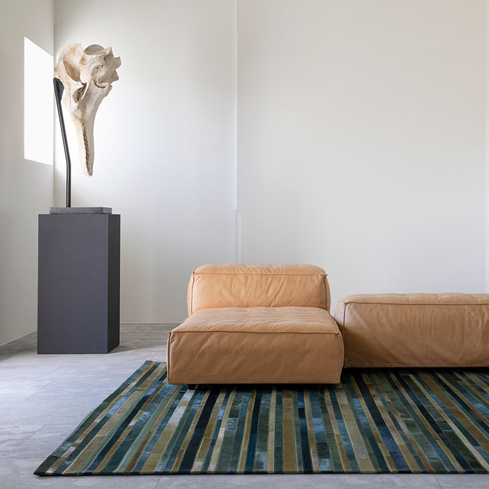 add a jewel tone spark: flash leather area rug in evergreen