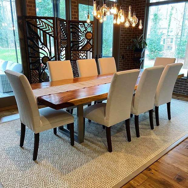 star of the show: scotland custom area rug in dining roomimage provided courtesy of @linaycarpetinteriors