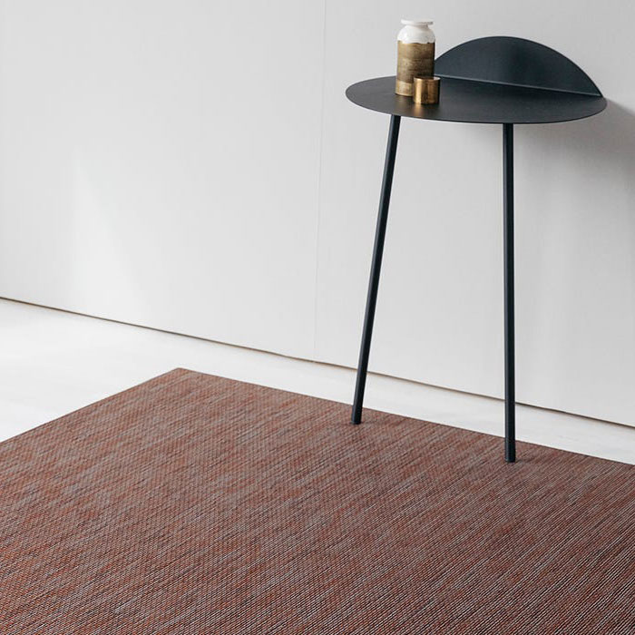refined area rug: wabi sabi area rug under side table (in color sienna)