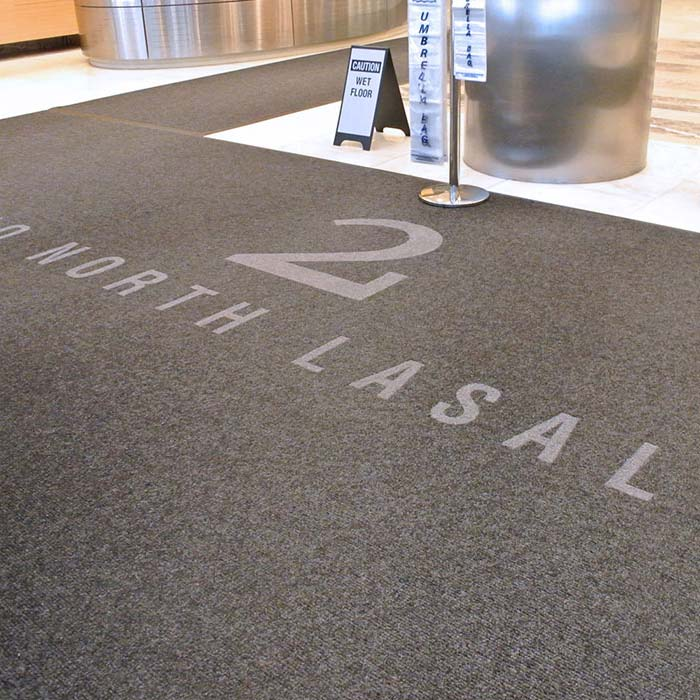 get name recognition: murray with a custom logo in an entryway